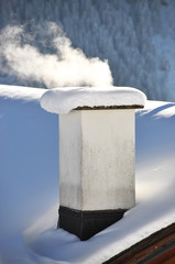 Smoking chimney of a Swiss cottage