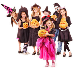 Halloween party with group kid holding carving pumkin.