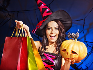 Woman holding Halloween shopping bag.