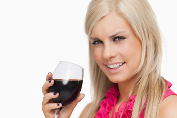 Smiling blonde drinking a glass of wine