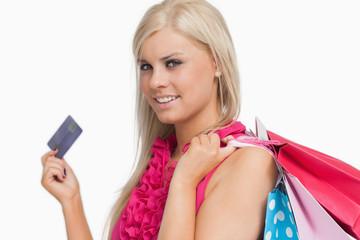 Smiling blonde holding credit card