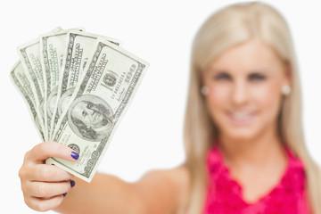 Beautiful blonde holding 100 dollars banknotes