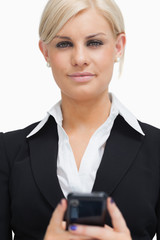 Businesswoman holding her mobile phone