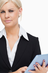 Green eyed businesswoman holding a tactile tablet