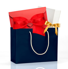 Dark blue shopping bag with gifts