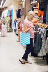 Woman is searching while holding a bag
