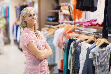 Smiling woman in clothes shop