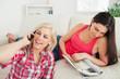Woman sitting on floor on the phone