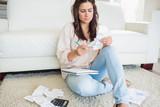 Woman looking at the bills