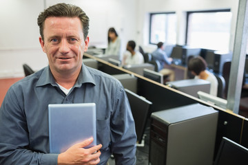 Man holding a tablet pc in computer room