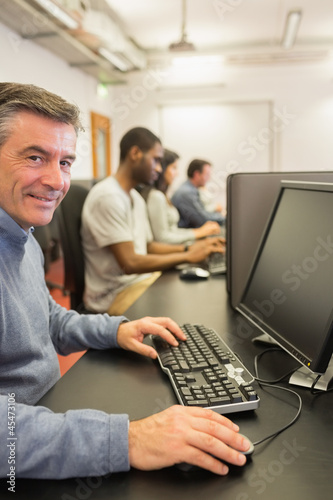 Smiling man working with the computer