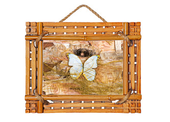 bamboo photo frame with abstract composition of butterflies, bir