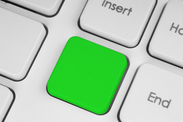Blank green button on the keyboard close-up
