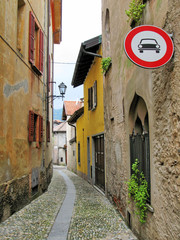 No motor vehicles sign on the narrow street of Cannobio, Italy