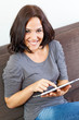 Woman smiling and electronic tablet