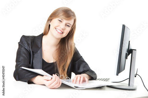 smiling businesswoman working with computer and documents