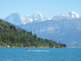 Famous Eiger, Moench and Jungfrau mountain peaks and the lake Th