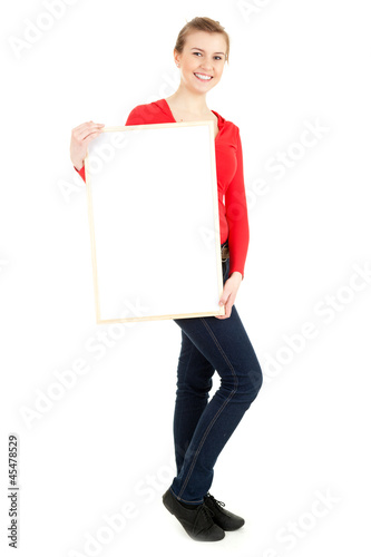 young woman holding blank poster, full length