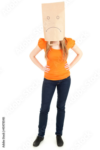 unidentified woman with sad paper head, full length