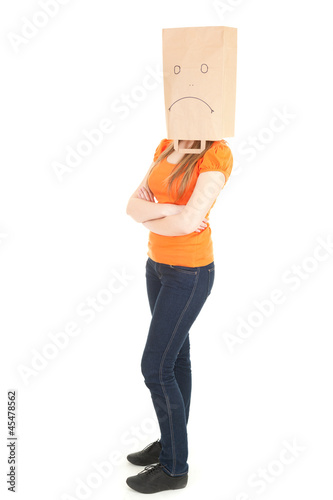 unidentified woman with folded arms and sad paper head