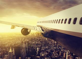 Airplane over a big City