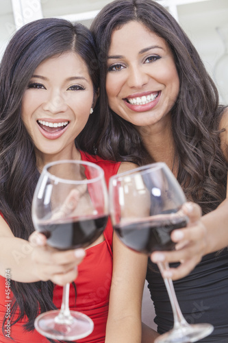 Two Happy Women Friends Drinking Wine Together