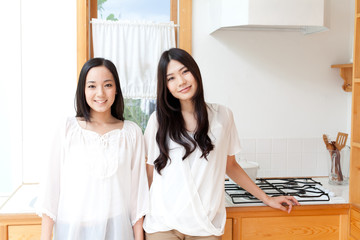 a young asian women in kitchen