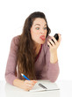 Woman pulling face at mobile phone