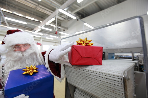 Santa claus receiving gifts from presents machine