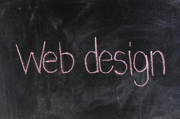 Conceptual hand drawn WEB DESIGN on black chalkboard.