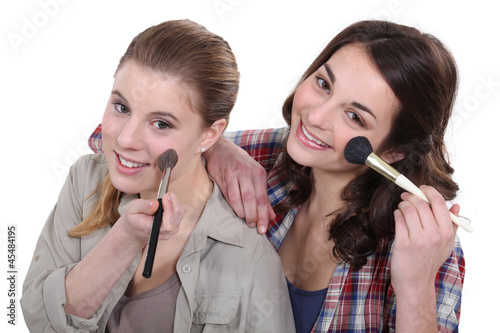 Two women pampering themselves