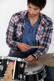 Young playing drums