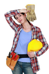 Tired female builder