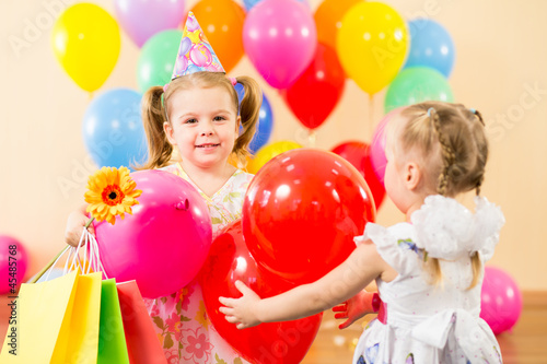 pretty children with colorful balloons and gifts on birthday par