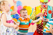 joyful kids with clown on birthday party