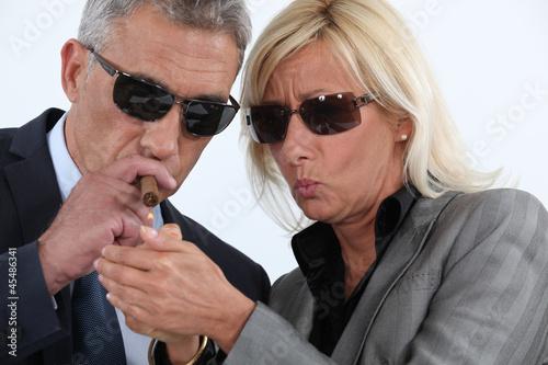 Man lighting cigar