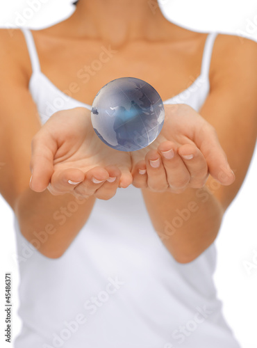 woman hands holding earth globe