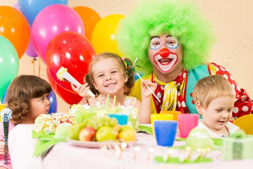 kids celebrating birthday party with clown