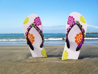 Flip-flops in the black volcanic sand of Tenerife island, Canari
