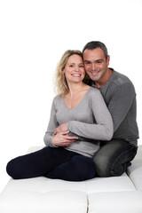 Couple hugging on sofa