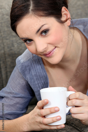 Young woman with a mug of tea