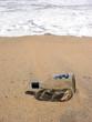 Empty bottle in ocean surf