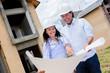Engineers holding blueprints