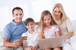 Happy Family Shopping Using Laptop