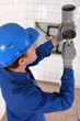 Plumber gluing grey water pipes