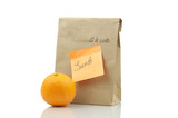 Paper Lunch Bag With Orange Isolated On White