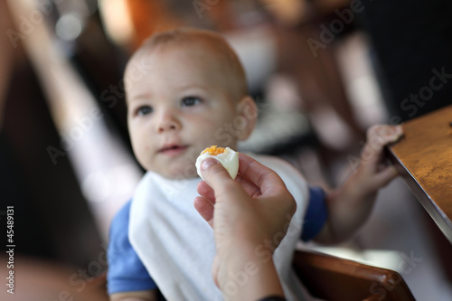 Toddler eating boiled egg