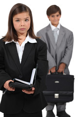 Little boy and girl dressed in business clothing