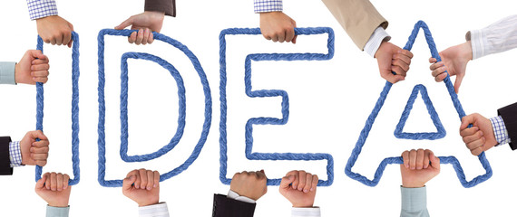 Hands holding blue letters forming Idea tag
