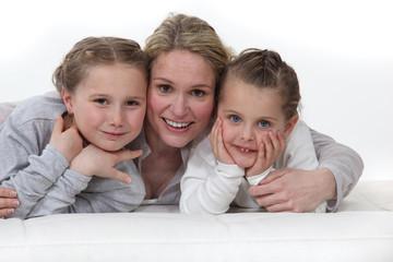 Woman hugging her kids